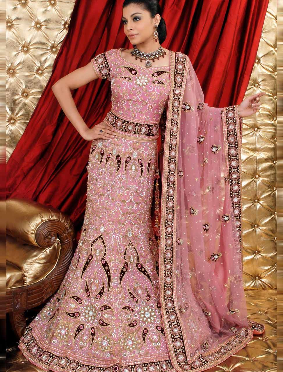 Very ornate pink, short-sleeved lehenga choli, with black accents ...