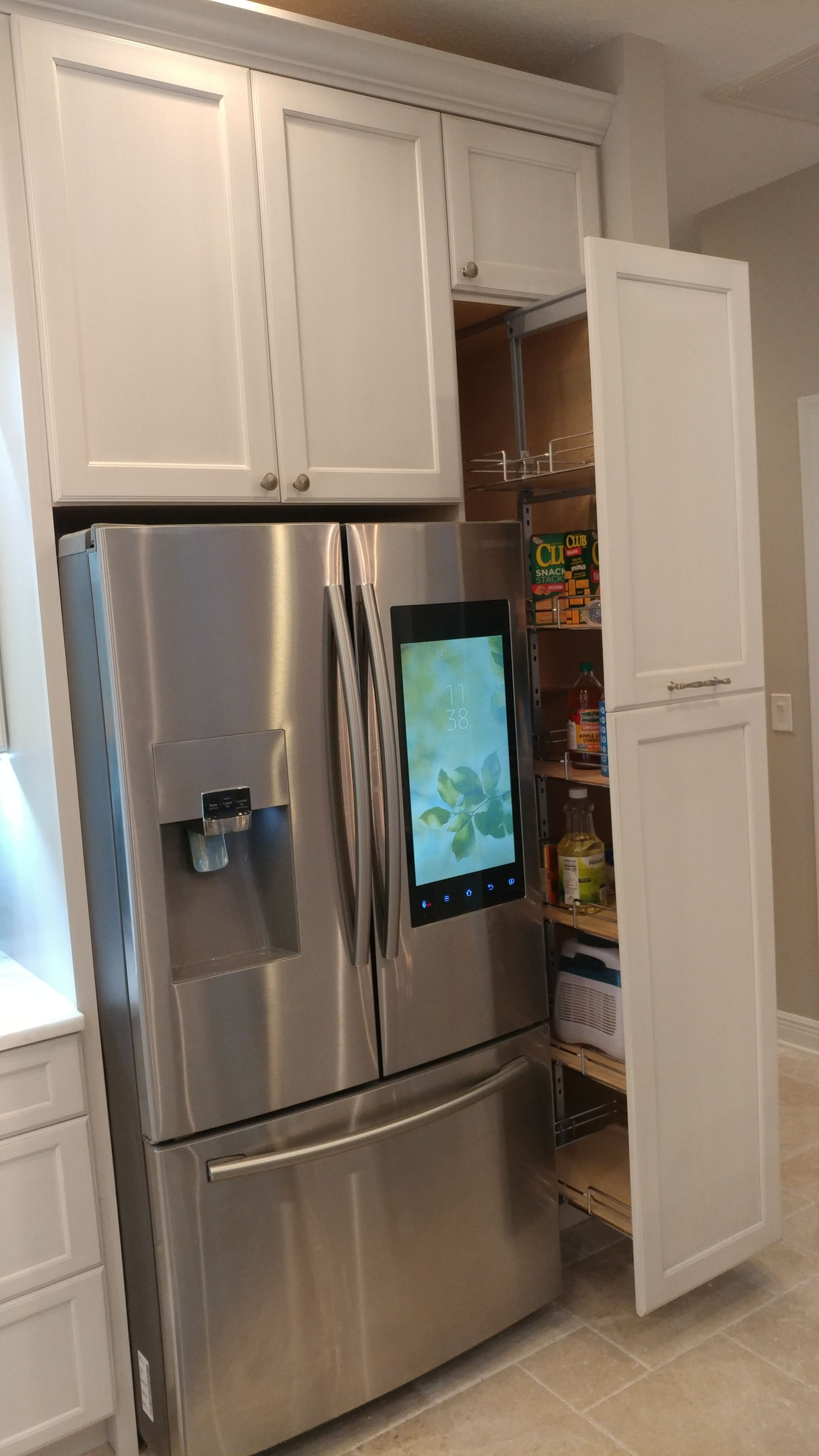 A Chrome Pantry Pullout Maximizes Storage In A Small Space