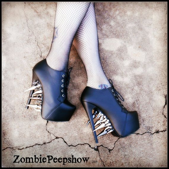 These ZombiePeepshow Riot platform boots are customized with multiple sized extreme steel and claw spikes. These were custom made for a client, so