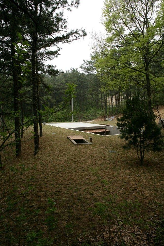 Galeria de Casa Terra / BCHO Architects - 4