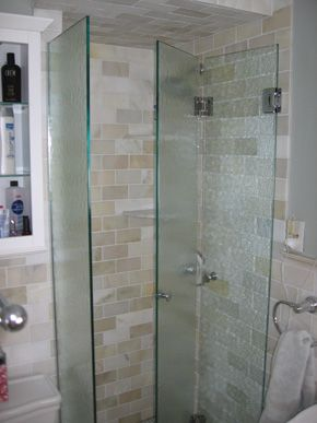 frameless bifold hinged dooreliminates any frame and fits our tiny bathroom since