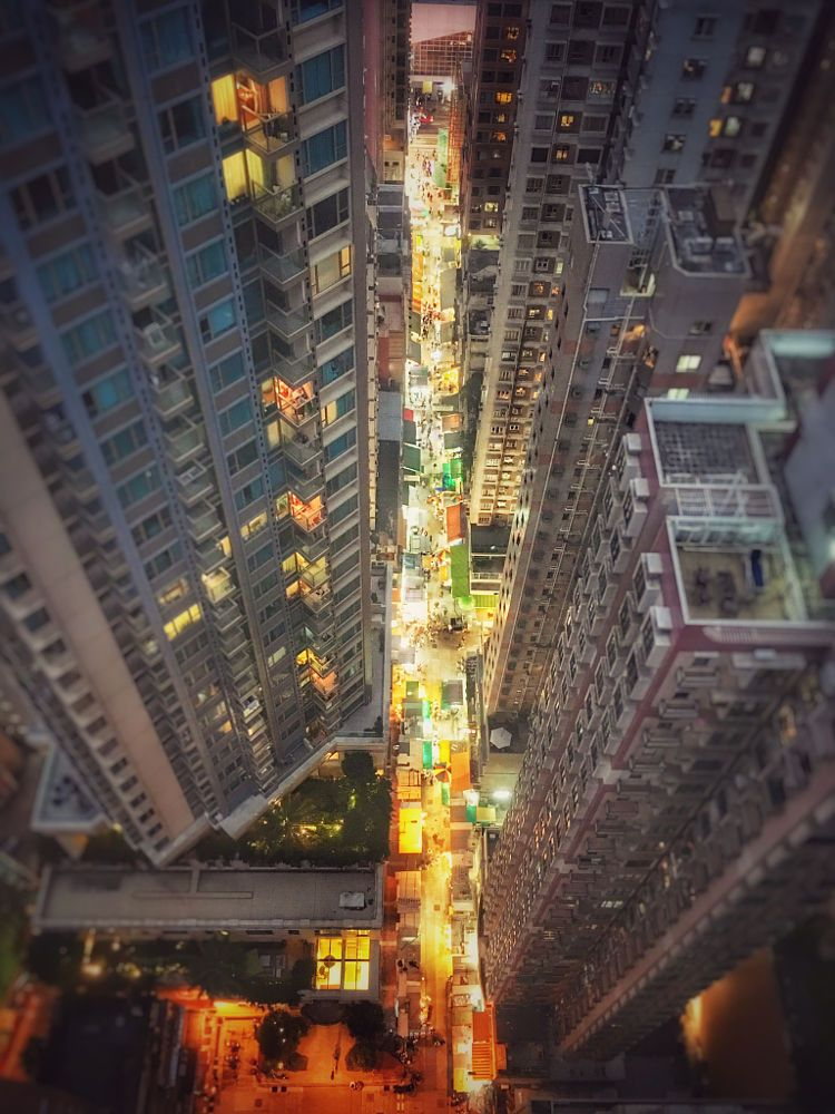 Above it all - looking down on the hustle and bustle of Wan Chai market in Hong Kong at dusk by Adrian Furner on 500px