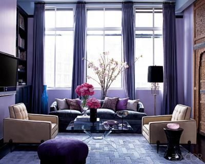 living rooms - windows curtains purple lilac rug sofa tan pink chairs ottoman blue Thanks to Elle Decor.