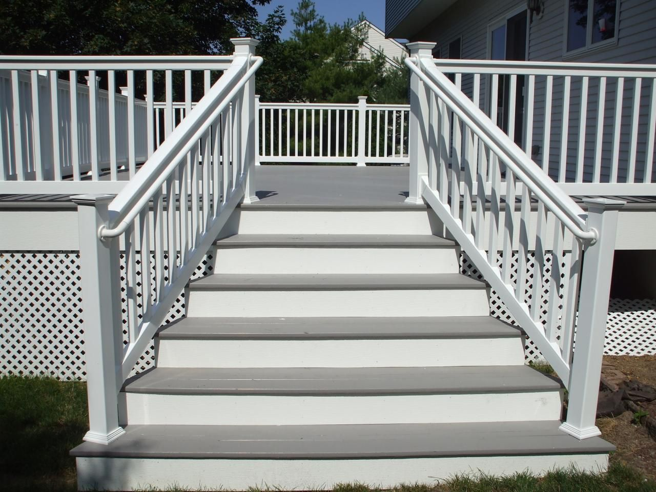 gray deck with white railings railing posts and white lattice for my future home. Black Bedroom Furniture Sets. Home Design Ideas