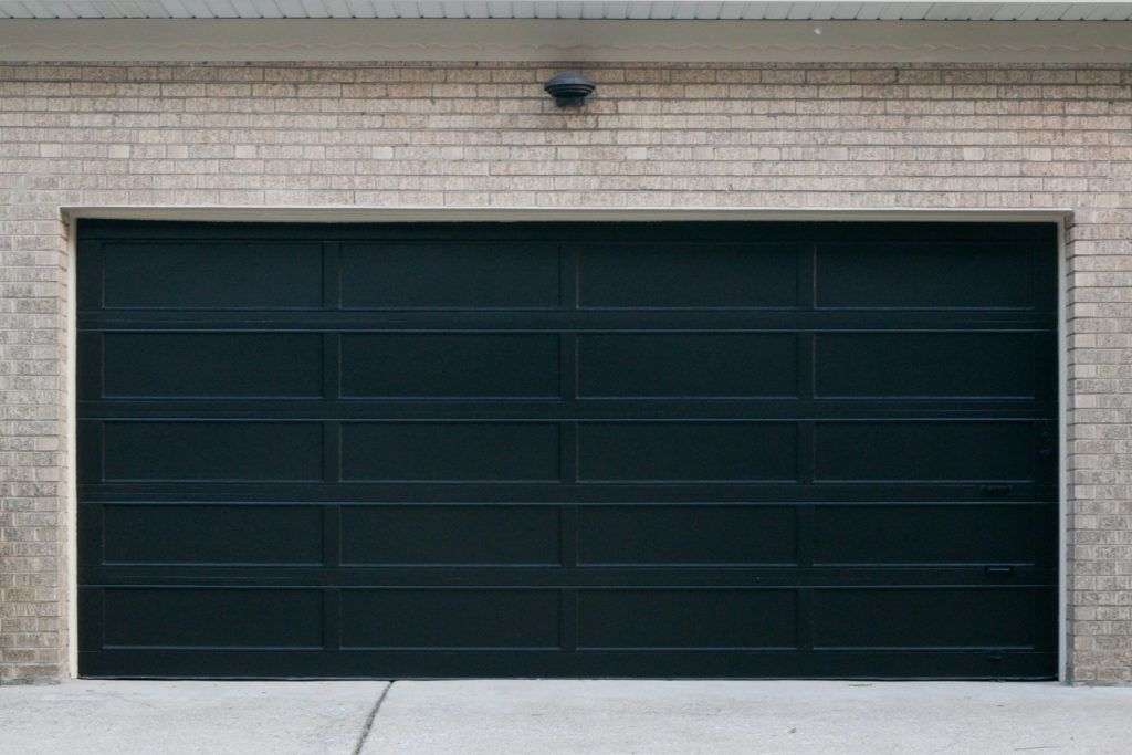 Step By Step Tutorial How To Paint A Garage Door The Diy Playbook Black Garage Doors Garage Door Paint Best Garage Doors