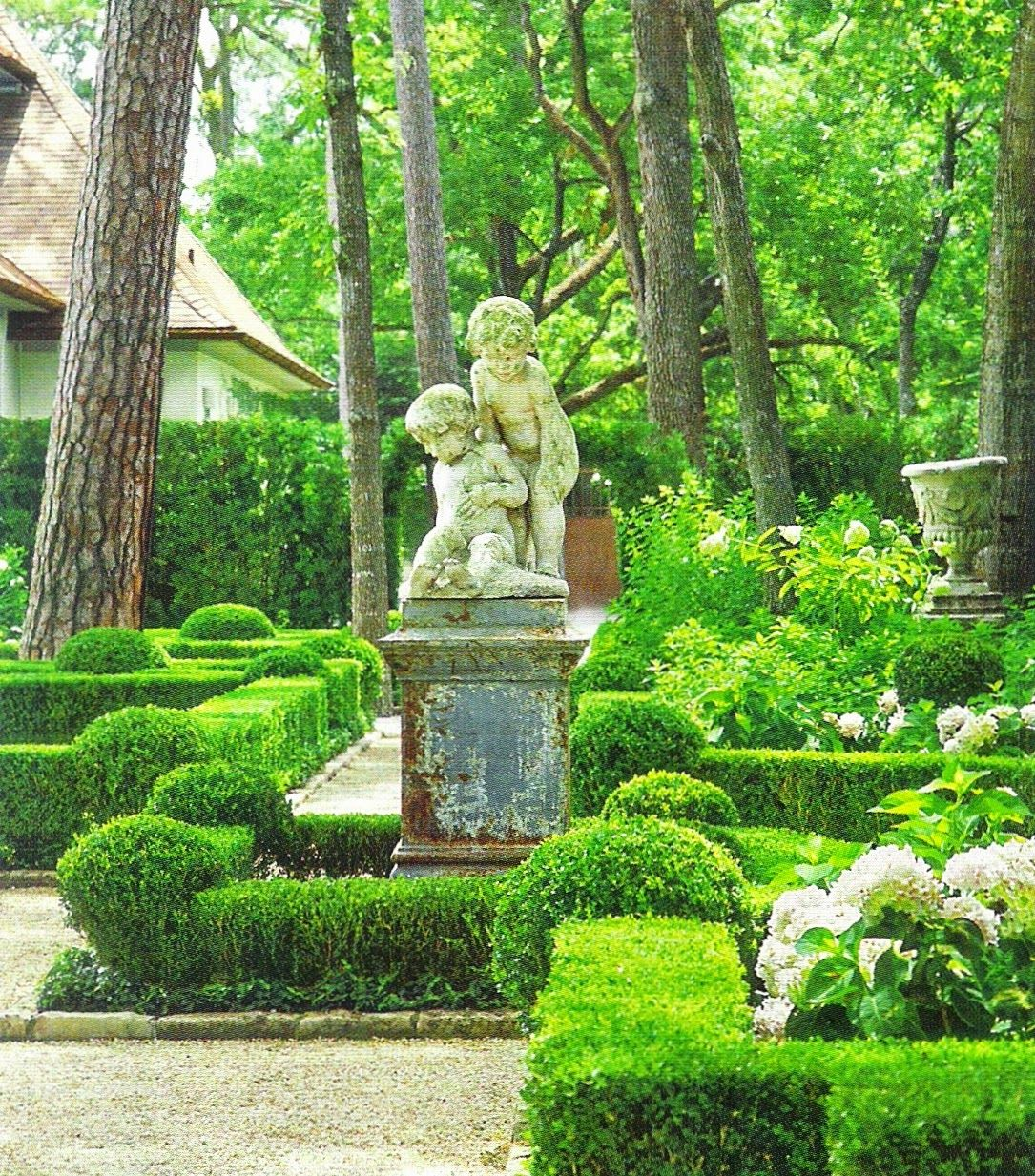 Clipped boxwood hedges outline parterres in exquisite for Garden deciduous trees