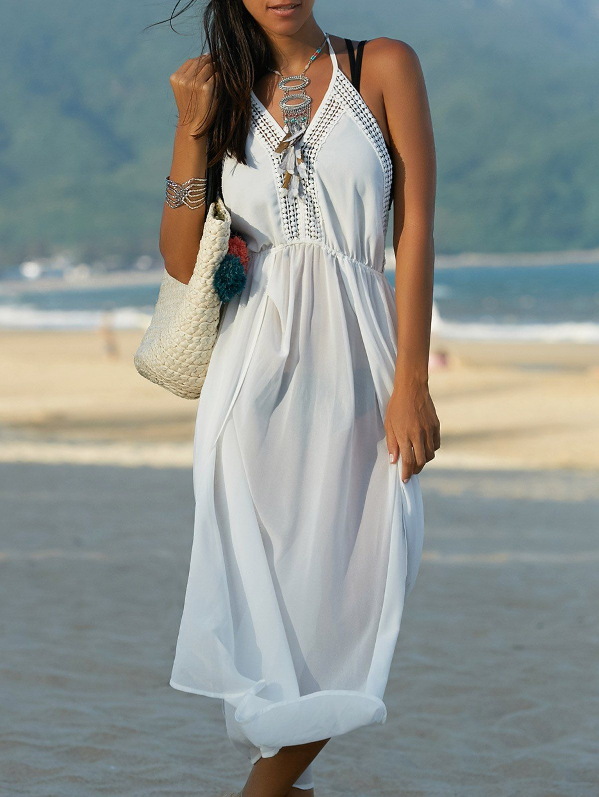 http://www.rosegal.com/bohemian-dresses/bohemian-halter-furcal-backless-solid-color-women-s-dress-497411.html