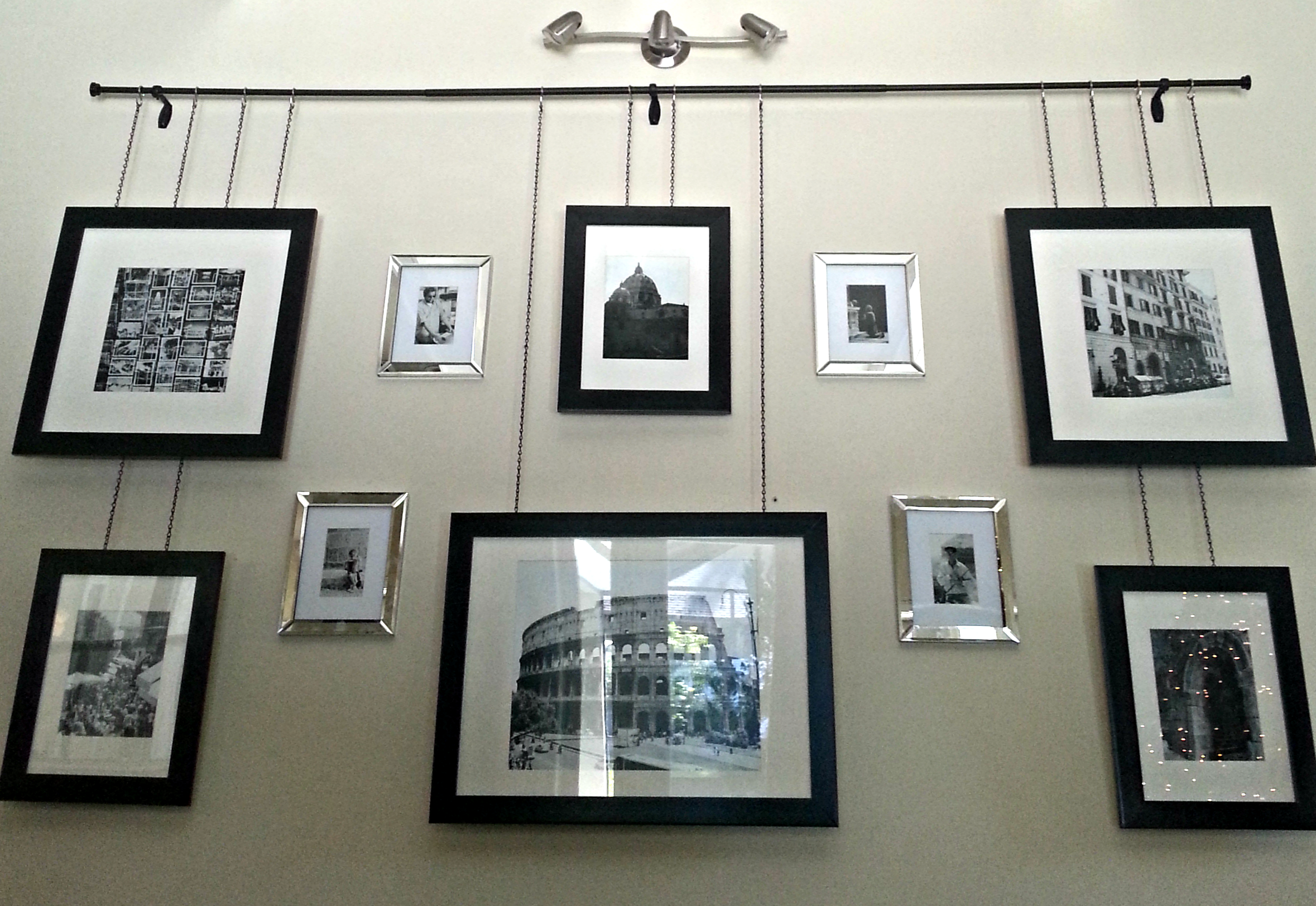 Gallery Frames Hanging By Chain From A Curtain Rod With