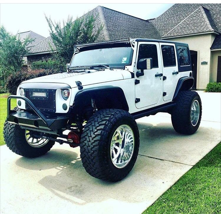 White Jeep Jk With Unique Front End Wheels Lift Led Light And