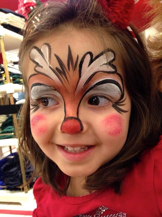 Christmas Facial.Reindeer In A Cartoon Style Face Painting Christmas Face