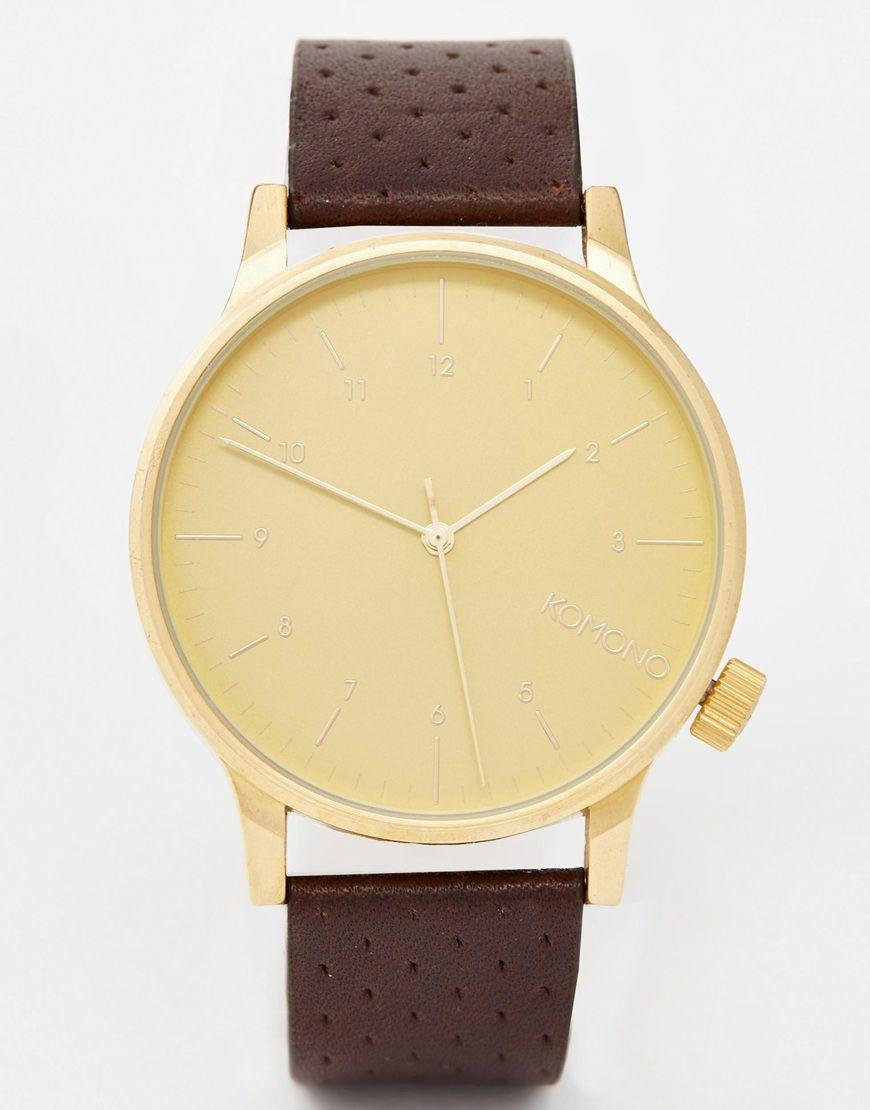 Armbanduhr von Komono perforierter Lederriemen drei Zeiger Ziffernanzeigen Dornschließe