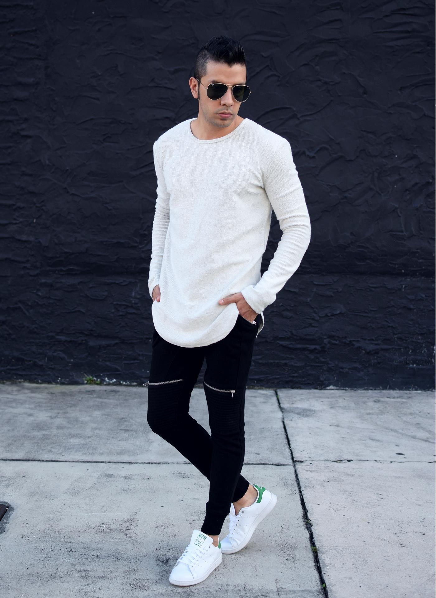 3cc0d235cf Dress in a white long sleeve t-shirt and black track pants for a comfy