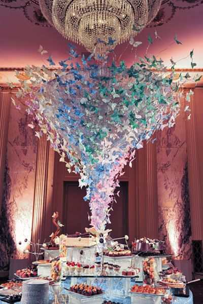 Splurge on a unique décor element your guests can't miss, like this cool butterfly chandelier. Bonus: You can later use as decoration in your new digs as a married couple.