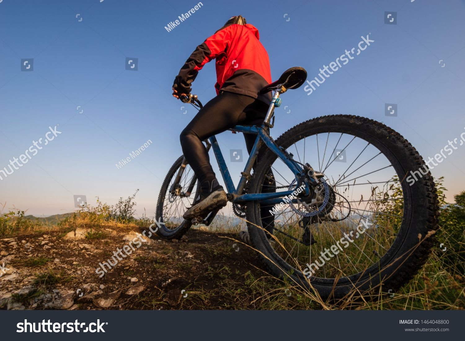 Cyclist On A Bike Admiring The View From The Top Of The Hill Ad