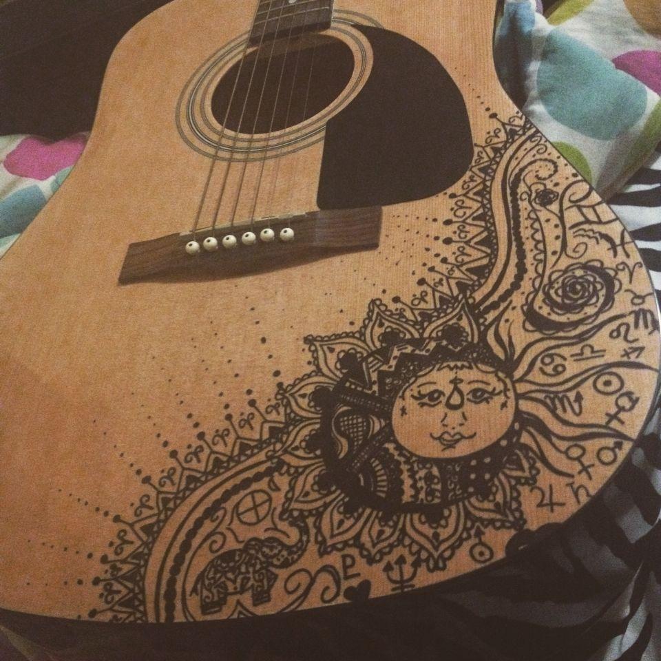 Sun and moon design on my guitar