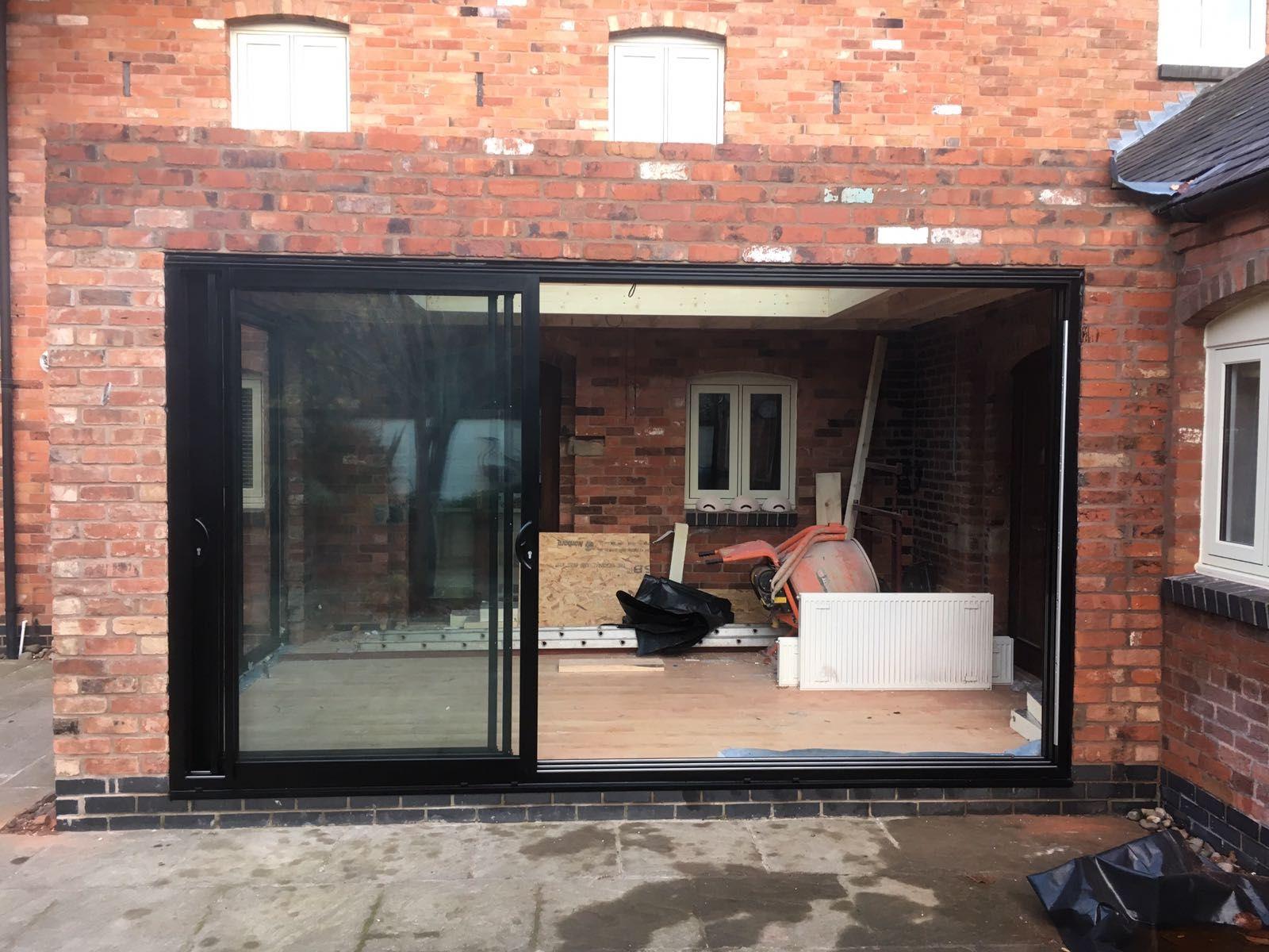 black smart architectural aluminium triple track sliding patio
