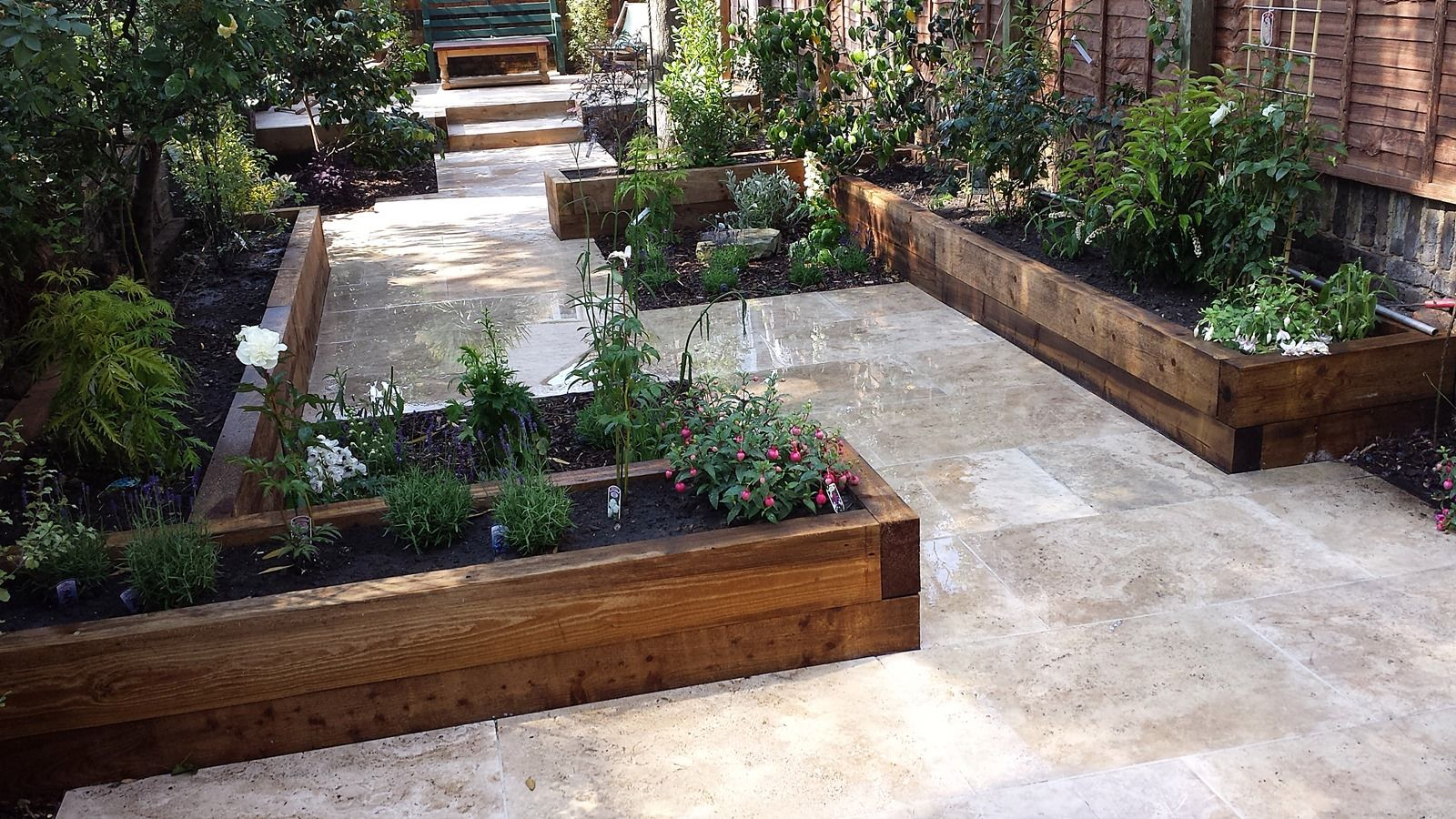 Travertine paving patio garden wandsworth london raised for Garden design ideas short wide