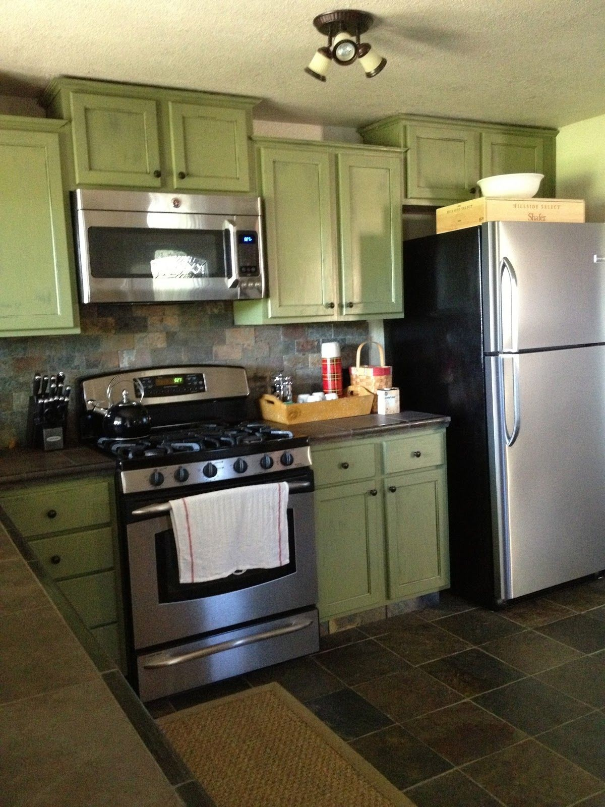 Sage Green Kitchen Cabinets With Black Appliances Green Kitchen Cabinets Green Country Kitchen Kitchen Design Small