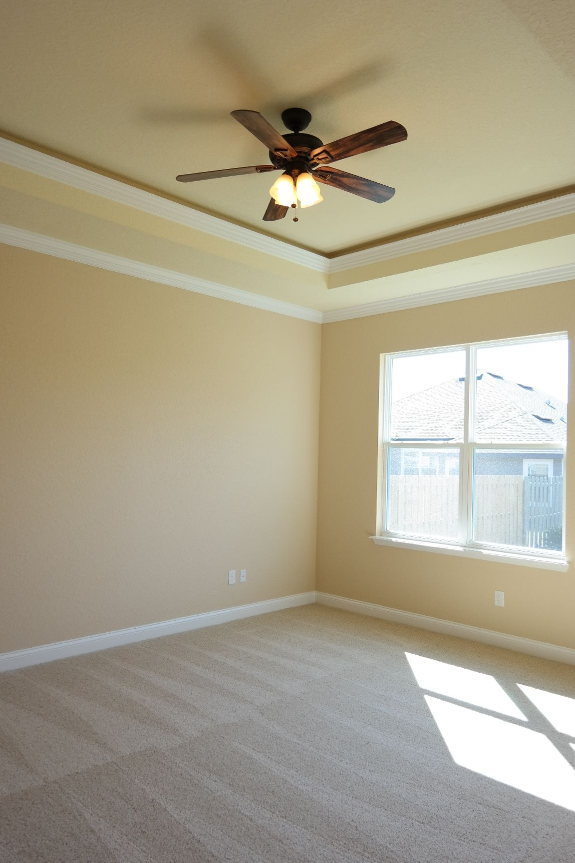 The Master Bedroom Features An 11 Trey Ceiling And Crown