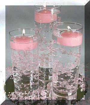 Velas em taças/copos com água