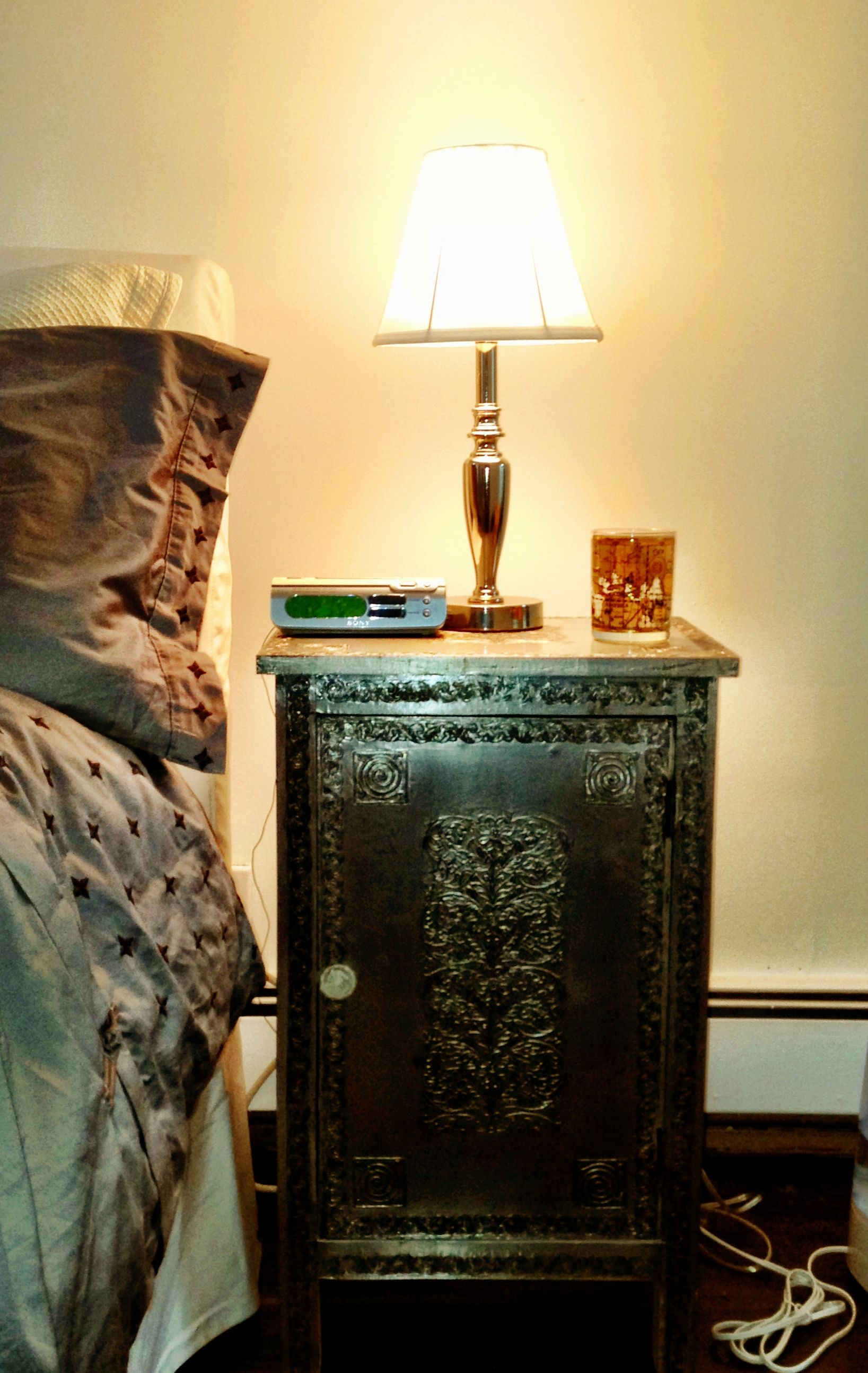 Silver metallic nightstand embossed with Indian designs, purchased ...