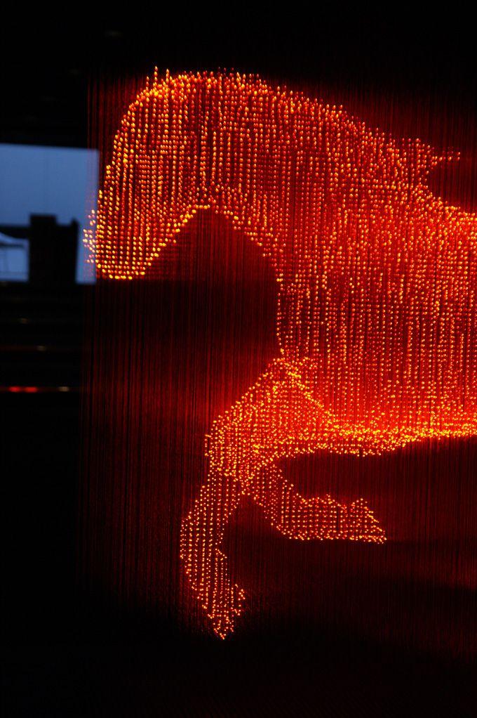 Horse sculpture made of strands of light by Japanese artist Makoto Tojikil. #art