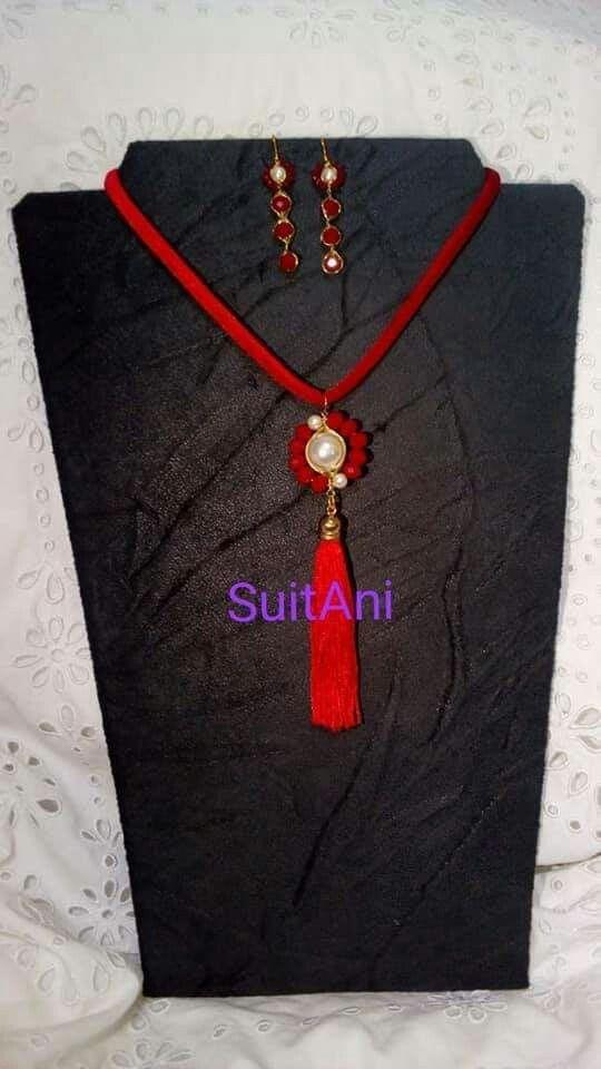 a8e1fbde4325 Collar perla y borla roja