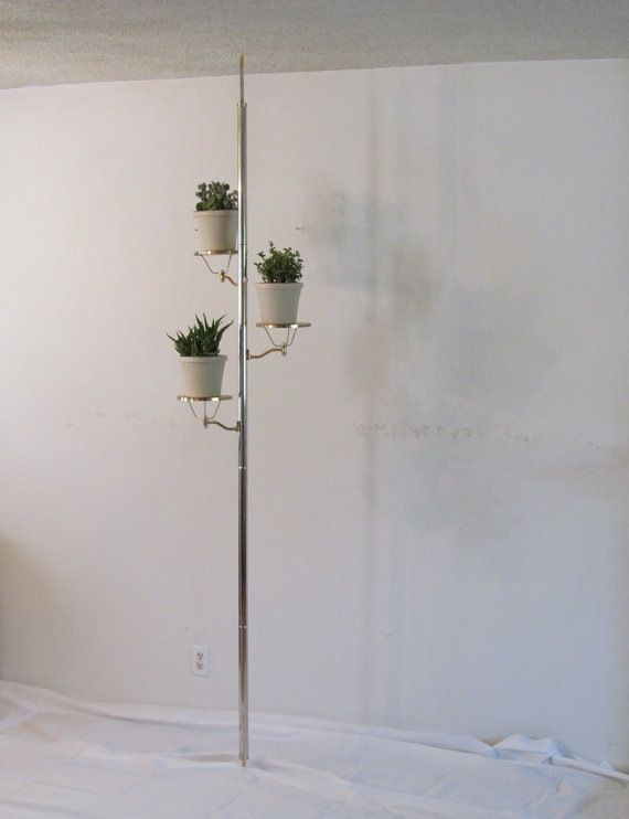 A Mid Century Tension Pole Plant Stand Mid Century