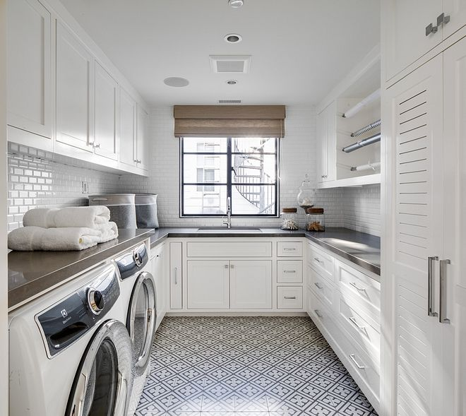 Modern farmhouse laundry room with white cabinets and black and white patterned floor tile Laundry room cabinets are Simply White by Benjamin Moore and countertop is Uliano, Pental Quartz #laundryoom #farmhouse #modernfarmhouse #blackandwhite