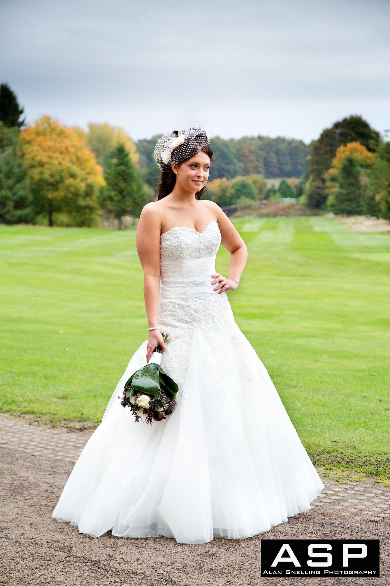 A stunning bride in her beautiful wedding dress, taken during her ...