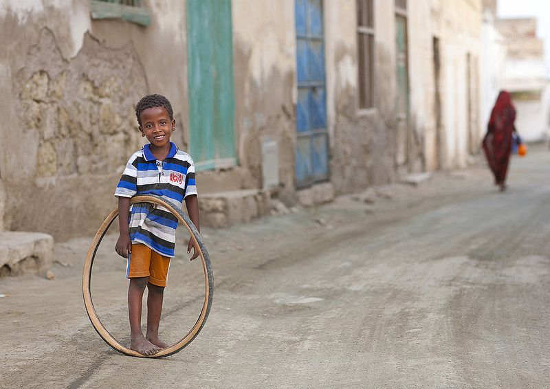 Kid Playing With A Bicycle Tyre, Massawa, Eritrea   © Eric L…   Flickr