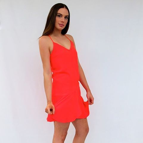 """You will feel amazing in our new """"Zesty"""" Midi Dress now online! Pair it with a black lace heel and tortoiseshell sunnies! #inselly #dress #orange #jualminidress"""