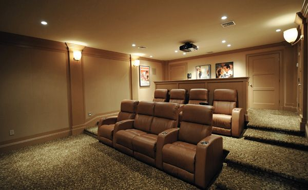 I like the Brown leather home theater chairs. The custom riser is a ...