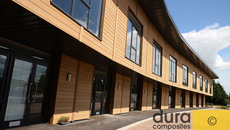 Composite timber cladding with a natural wood appearance