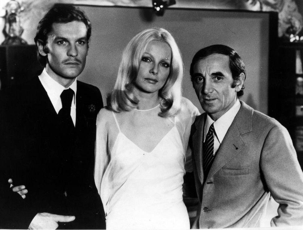 Virna Lisi in compagnia di Helmut Berger e Charles Aznavour