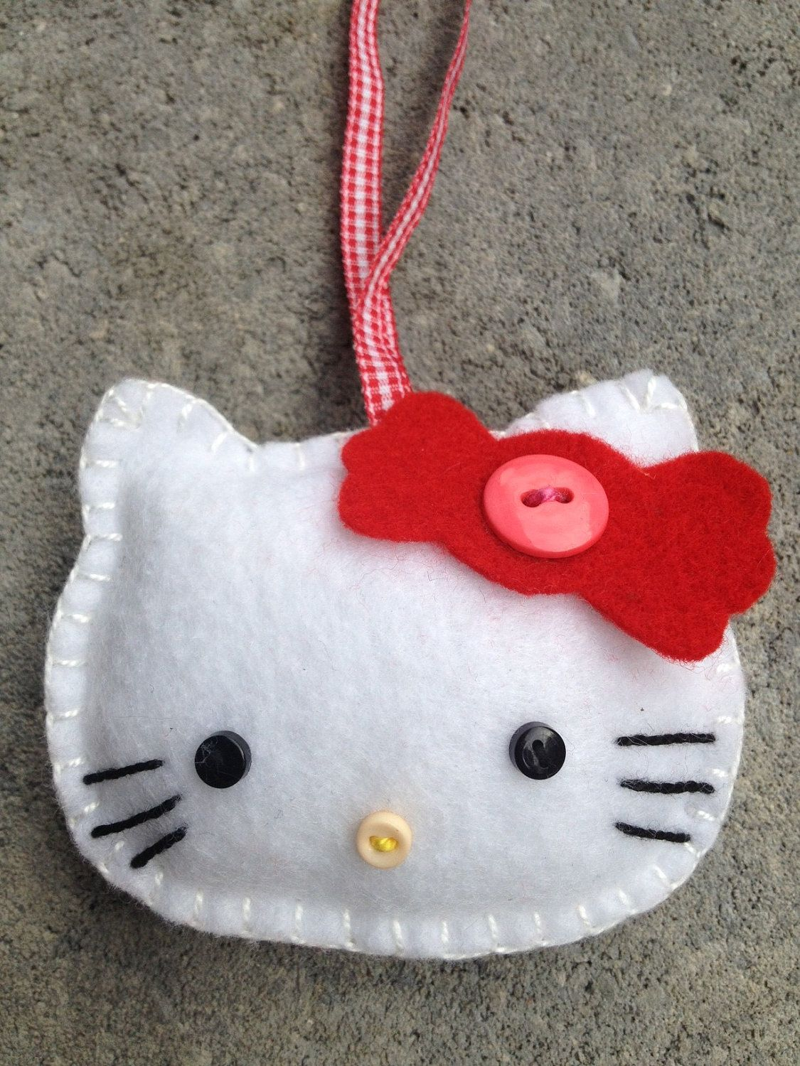 Hello Kitty Ornament/Toothfairy. 7.99, via Etsy. (With