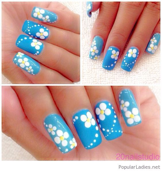 long blue nails with white flowers