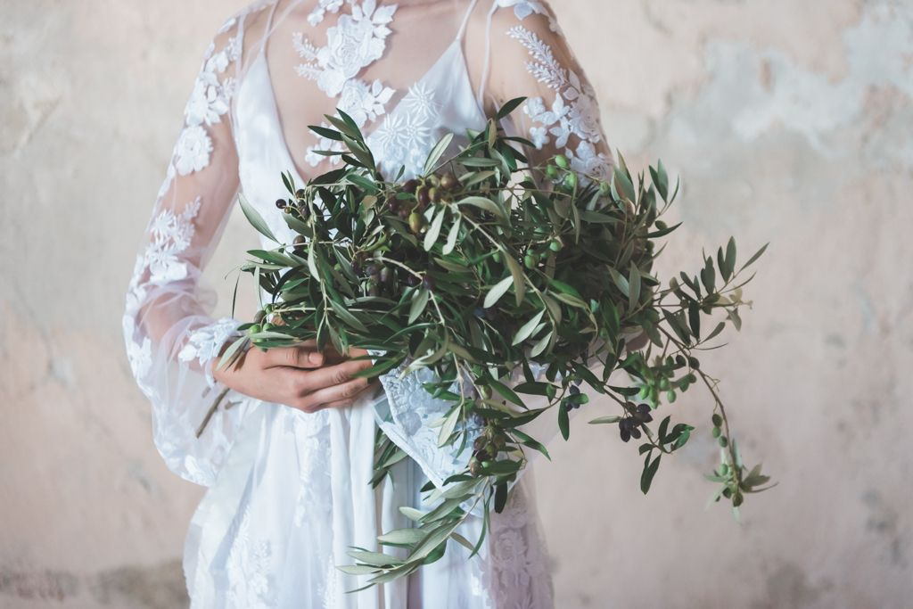 Olive filled countries like Greece, Italy and Croatia are perfect for a destination wedding. Olive filled = sun filled. Also, plenty of delicious food and lots of beautiful olive leaves to decorate with.  Photo: Wit Photography Dress: Odylyne the Ceremony Floral design: @celsiafloral Celsia Floral