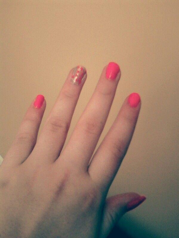 Pink nails with gold accent nail and pink polka dots