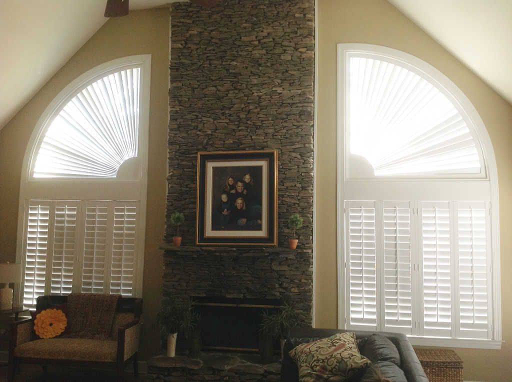 Poly Plantation Shutters On Large Windows And Arches By A Fireplace Arched Plantation