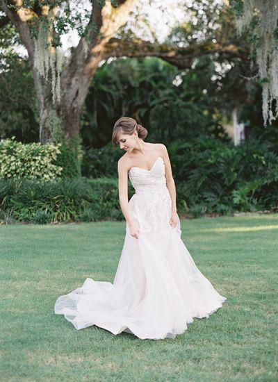 I like the greenery of the background.  sweetheart neckline   Jessica Lorren #wedding