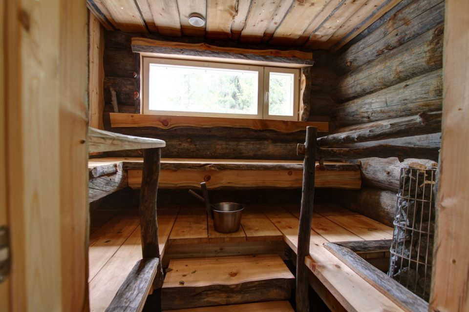 This modern log cabin in Finland has two bedrooms and a