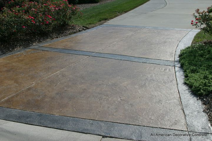 Faded driveway after being stained with brown and grey for Remove stains from concrete driveway