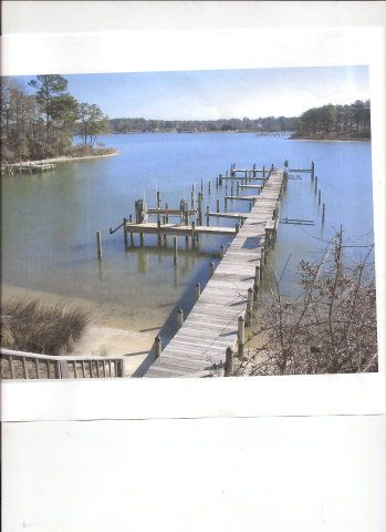 BOAT SLIP comes with this Last Lot left in lovely subdivision in Deltaville. Cleared half acre is ready to build your Dream home. 3 bd perc letter in hand.  Dock is just around bend to mouth of Rappahannock river and the Chesapeake Bay. Selling for $60,000 call Helen Edwards, broker 804-776-8494 Edwards Bay & River Properties
