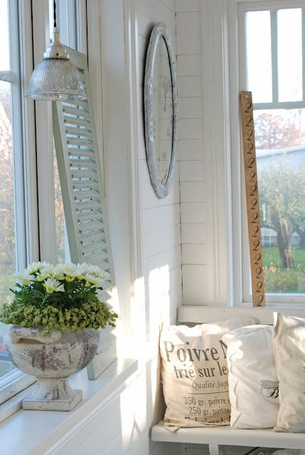 French farmhouse, simple living, french script pillows, mirror, white room, green plants in silver bowl