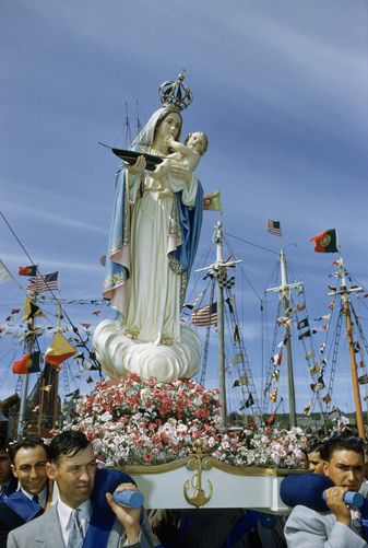 612540.  Fishermen carry a statue in a blessing of the fleet procession.