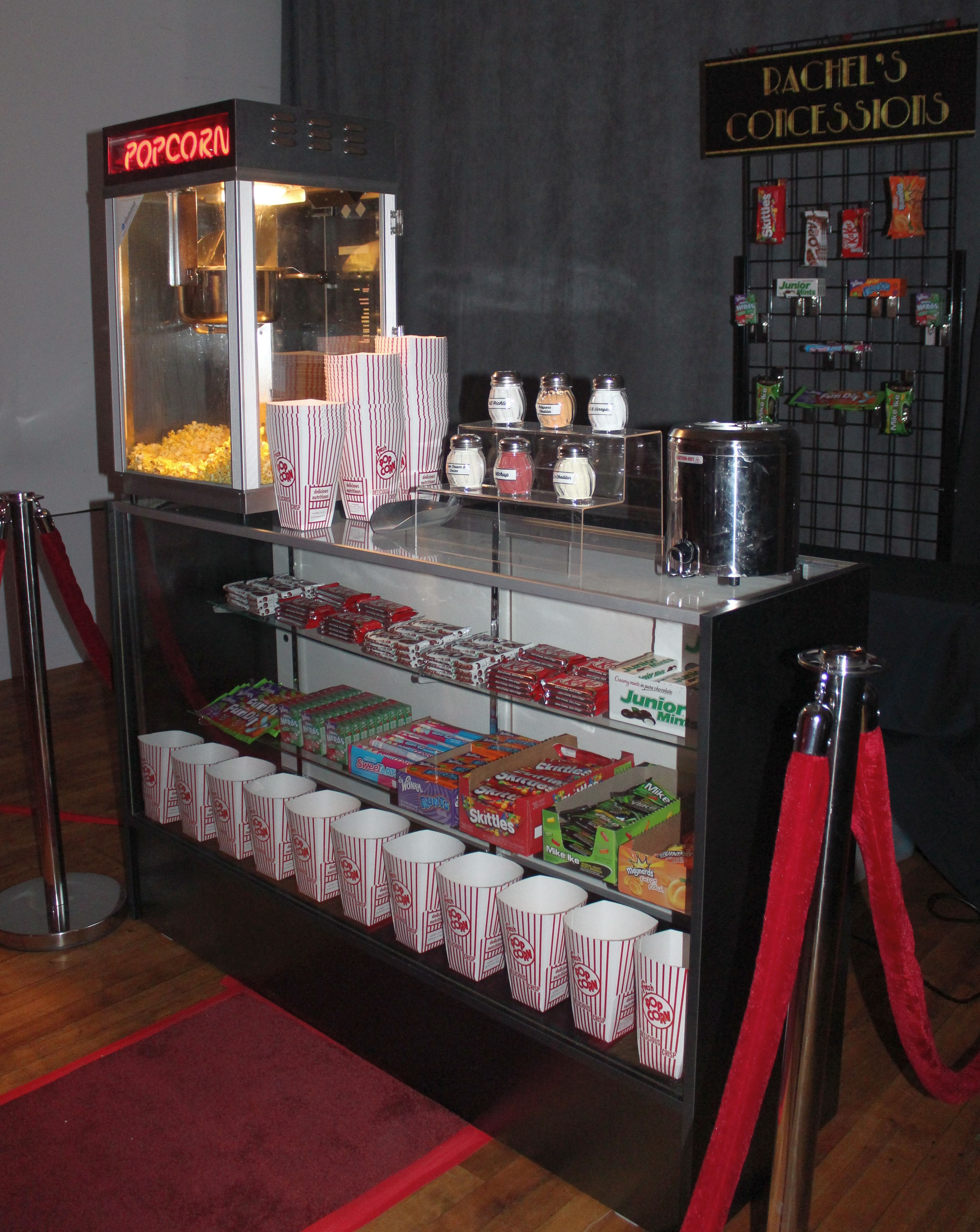 Pop S Concessions Creates A Fun Movie Theatre Vibe Complete With Candy Popcorn And Snacks With At Home Movie Theater Home Theater Seating Theater Room Decor