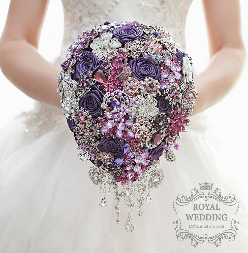 Wedding bouquet brooch bouquet bridesmaids bouquet silver bridal beautiful cascading wedding brooch bouquet with a fine mix of fuchsia and silver brooches gorgeous crystals and purple satin flowers izmirmasajfo