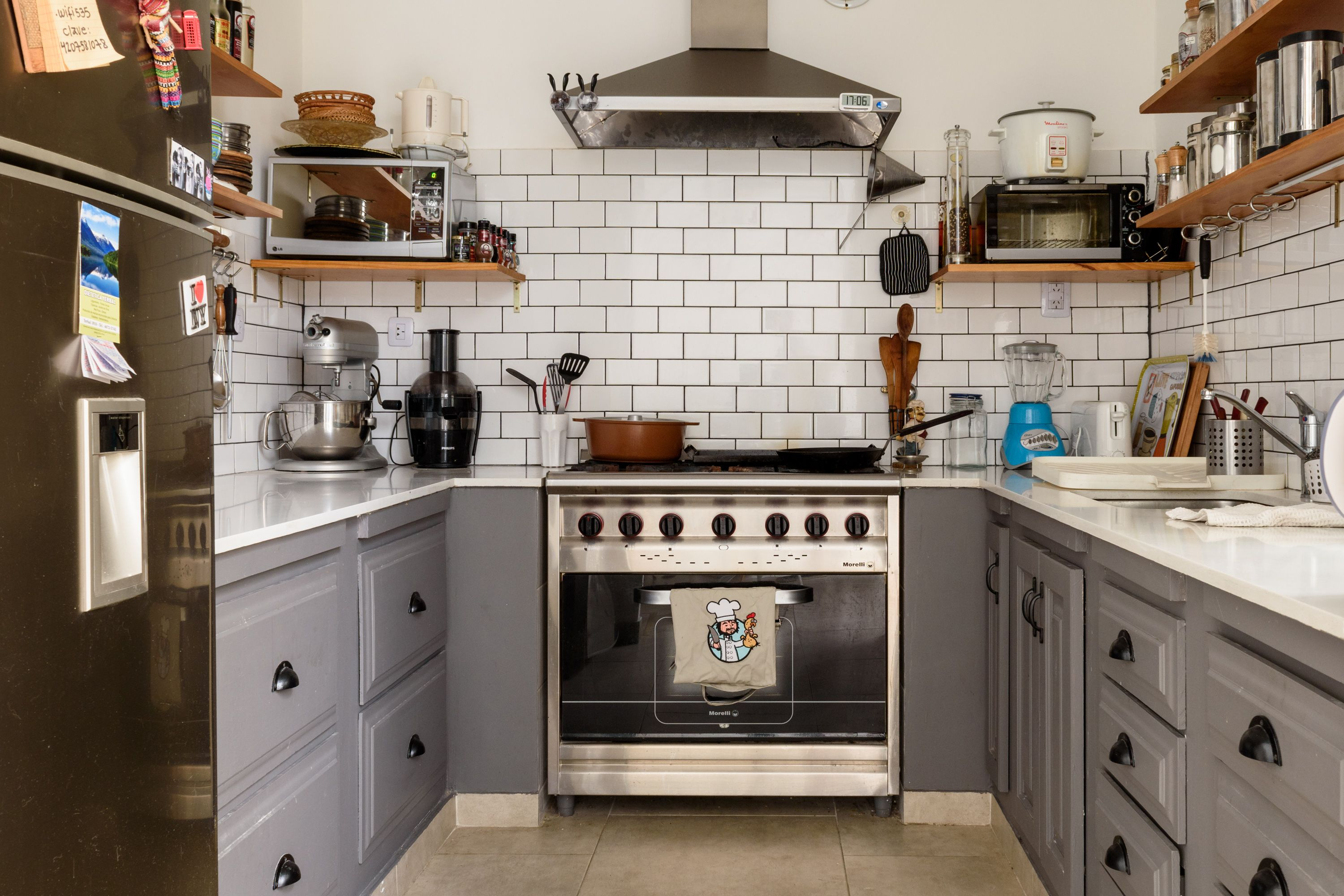 The kitchen was a gut renovation completely DIYed by Lionel. He installed tiles, cabinets and appliances.