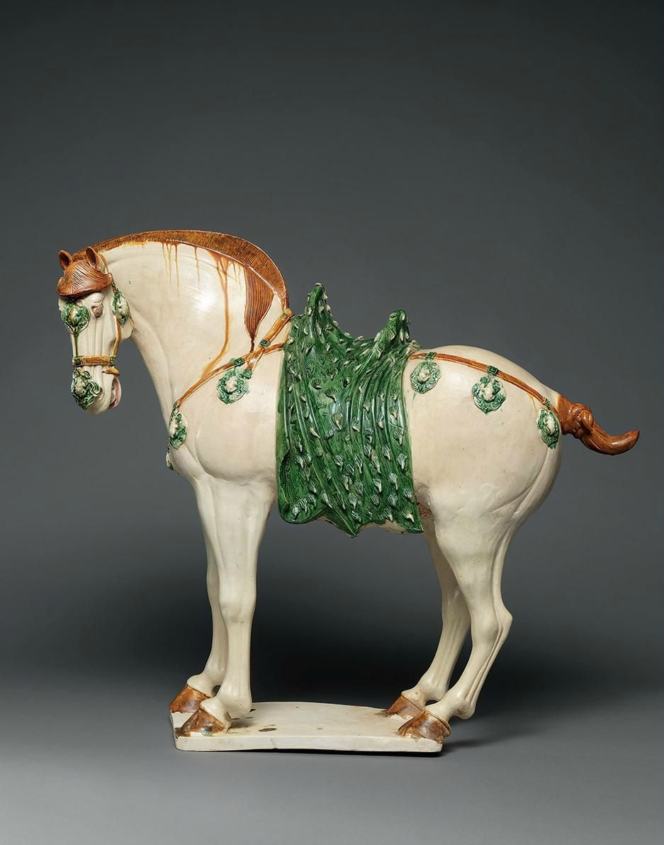 A large sancai-glazed figure of a caparisoned horse, Tang dynasty (618-907)